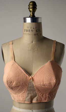 Italian bra from the 1950's, still no wires but lots of seams to help shape the breast, a lot of fabric as well (photo from The Metropolitan Museum of Art)
