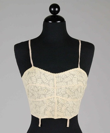 A longer bra from around 1935, more delicate lace but still not a lot of support or shaping (photo from The Metropolitan Museum of Art)